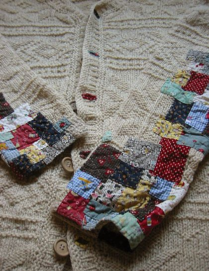 A knitted cardigan slowly transforming into a patchwork cardigan as it ages.