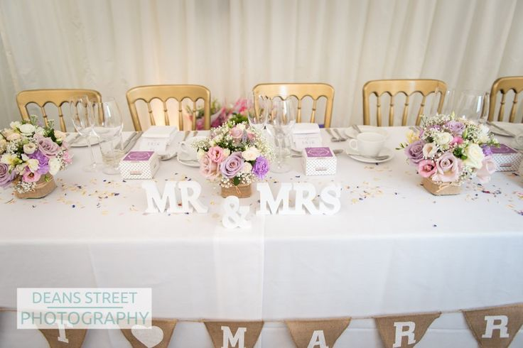 Small flower designs for the top table are perfect for a country wedding