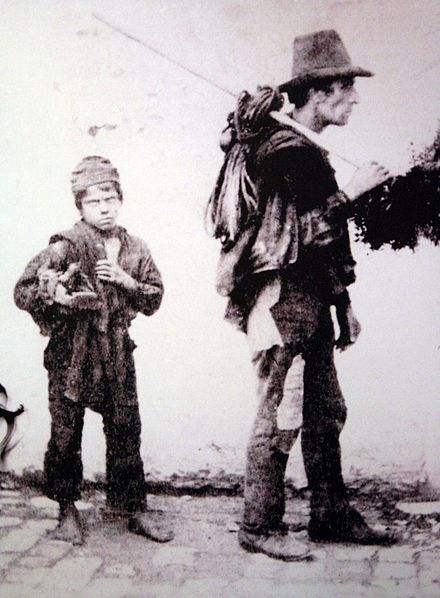 Italy. Chimney sweep. A master chimney sweep and his apprentice boy in Italy (end of the 19th century)