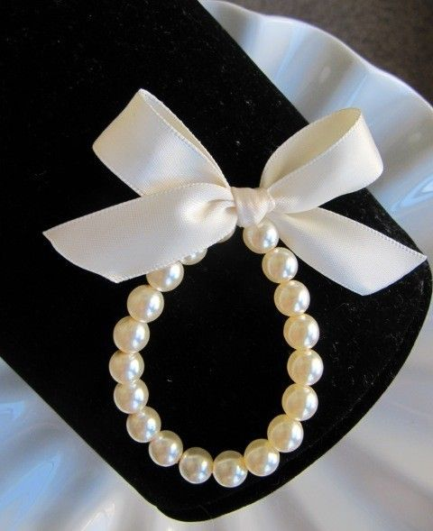 Little Girl Pearl Bracelet with ribbon for flower girls, toddler birthday, or babies photo prop. $8.95, via Etsy.