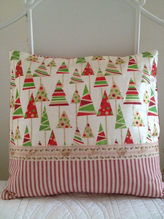 CHRISTMASTIME is around the corner... and this lovely one-of-a-kind pillow highlights the beauty of the holiday season, with a festive Red, Green and Gold Christmas tree designer fabric, combined with the simplicity of a holiday red cotton ticking.  I have added a beautiful rose Paris ribbon, embellished with sparkled stamped Gold Crowns. The back of the pillow is made from the same red cotton ticking and its finished with an envelope style enclosure so its easy to remove the pillow form…