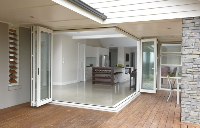 Corner bifolds add a dynamic transition between the indoors and outdoors.