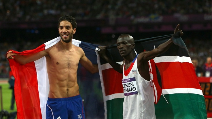 Photos - Ezekiel Kemboi - Athletics - Olympic Athlete | London 2012.   Medallists celebrate after the men's 3000m Steeplechase final.  (sun aug 5, 2012)    Gold medallist Ezekiel Kemboi of Kenya celebrates with the silver medallist Mahiedine Mekhissi-Benabbad of France after the men's 3000m Steeplechase final on Day 9 of the London 2012 Olympic Games at the Olympic Stadium.