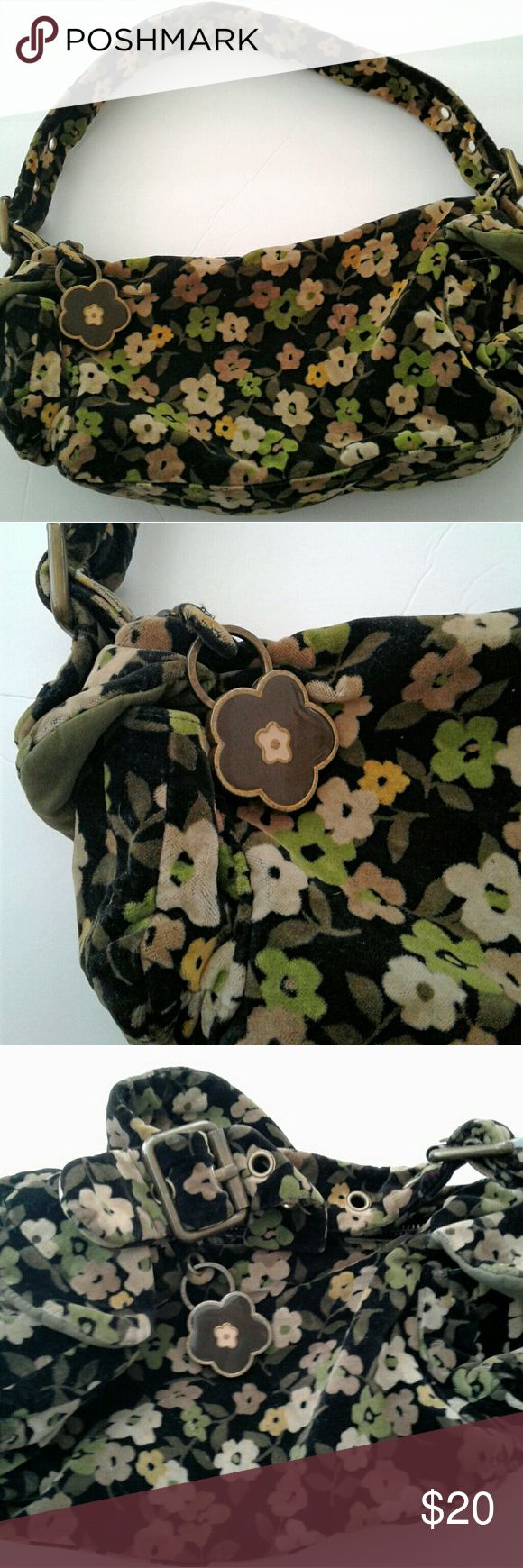 GAP Ladies Shoulder Bag,  Ladies Floral Purse Gap shouler bag,  with adjustable strap...  In great condition,  very clean on the inside and outside...  Velvet feel material 2 side pockets Zipper closure 1 pocket on the inside Sturdy hardware  15 inches long(flat lay) 7 inches tall (standing) GAP Bags Shoulder Bags