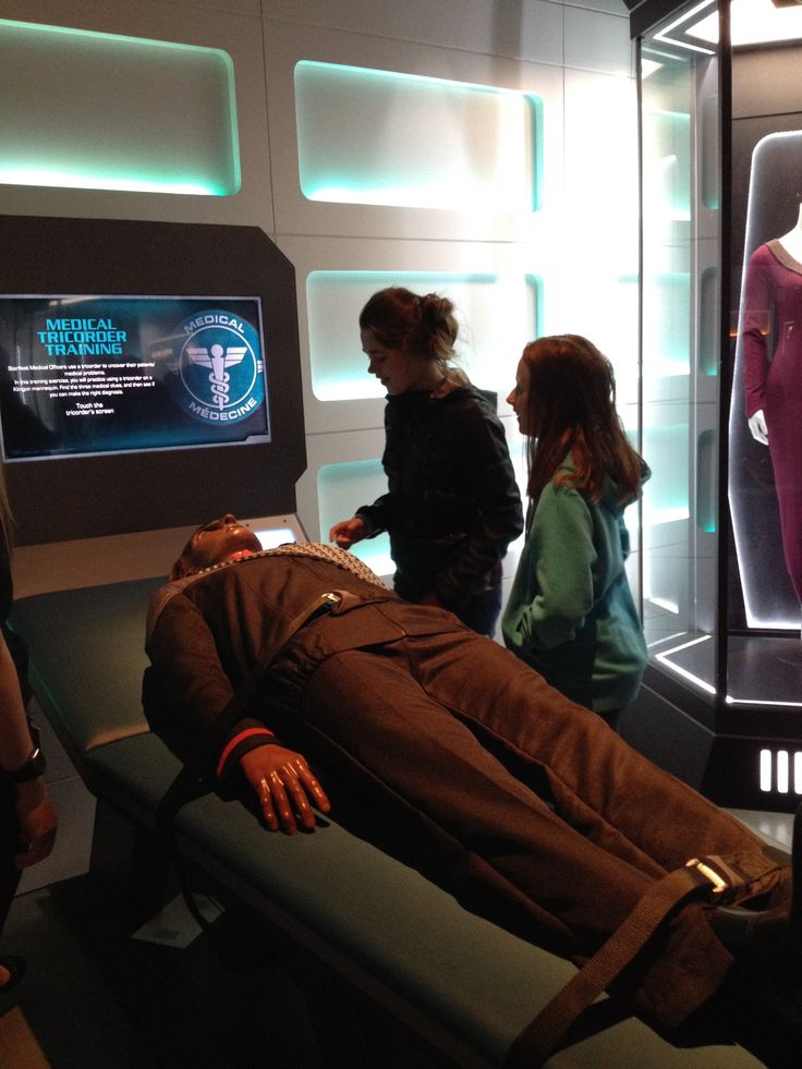Diagnosing an ill Klingon in the Medical simulation component of the exhibit Star Trek: The Starfleet Academy Experience at the Aviation Museum, summer 2016.  Scan with care!
