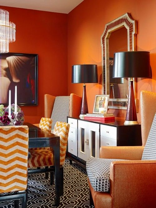 Color: Orange  Orange walls/ paint color and chairs in dining area