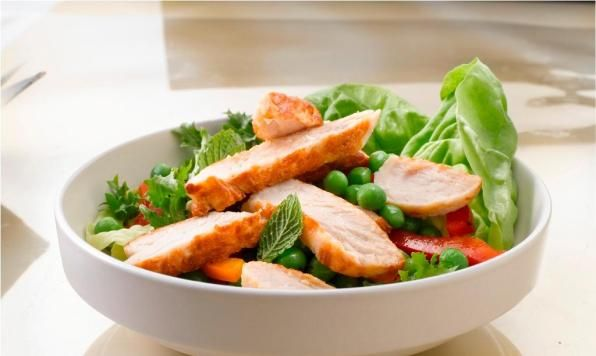 This fresh summer salad is topped with Maple Leaf Prime® Fully Cooked Turkey Breast Slices, chopped mint and drizzled with a light homemade honey dressing.