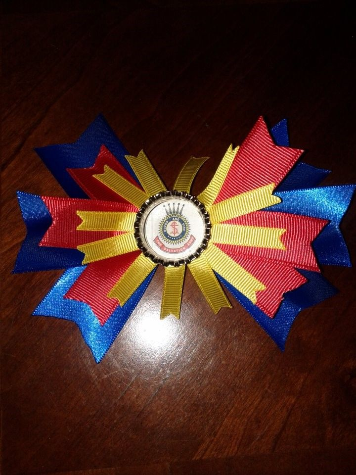 Bow I made for a Junior Soldier little girl. Bottle cap center with a Crest on a 1in. circle punch.