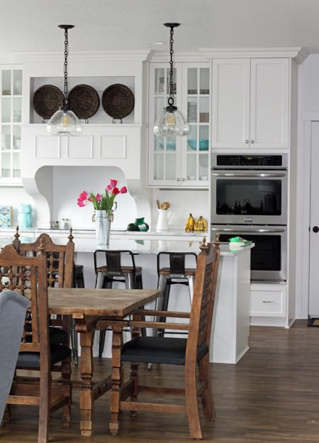 Large Farmhouse style kitchen layout with large island, white cabinets, and Frigidaire Gallery Double Oven set. Gorgeous!!