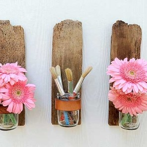 Mason Jar Sconce from Bourbon & Boots. Rustic and very doable. (Planks with mason jars attached with leather strip.)