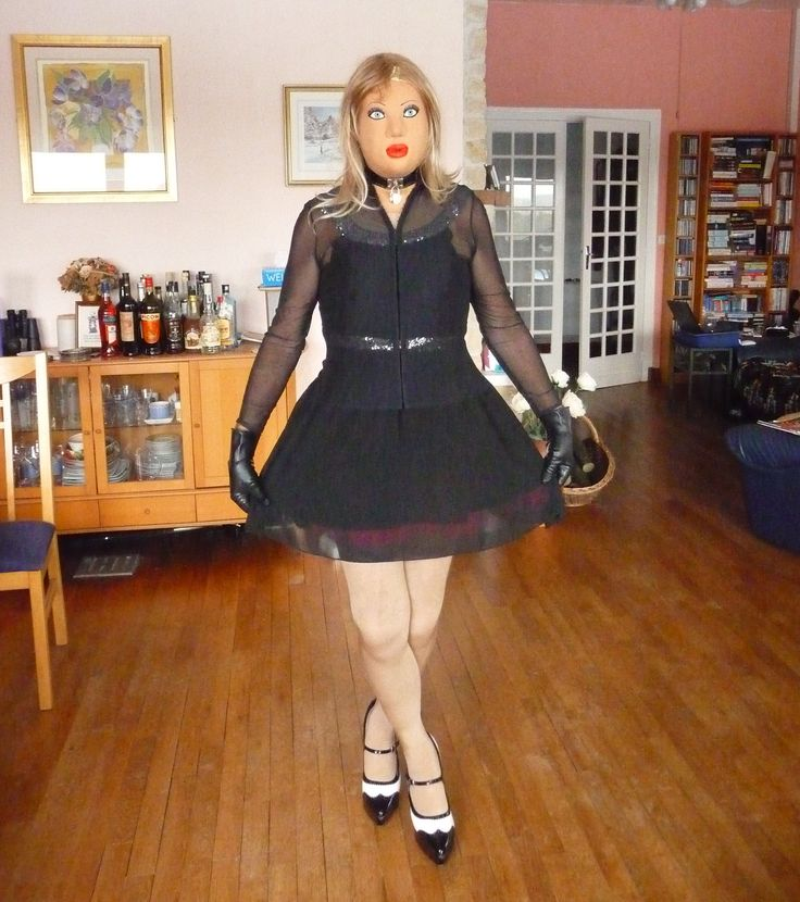 Little black dress with sequin trim and a net blouse to complete the outfit.
