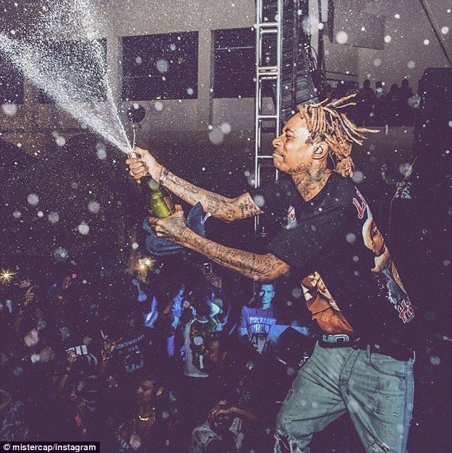 Ready to party: Wiz Kahlifa posts a picture of himself enjoying a night out