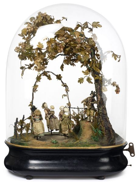 Phalibois automaton of 6 dolls dancing to a fiddler's tune. With 3 airs in his repertoire under the shade of an autumnal arbour, it's a portrayal of 18th Century courting couples, made in Paris in the late 1870s.