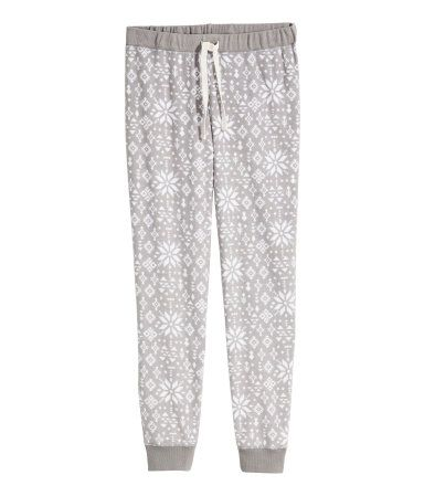 Pyjama bottoms in soft fleece with an elasticated drawstring waist and elasticated hems.