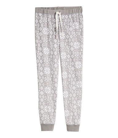 Pyjama bottoms in soft fleece with an elasticated drawstring waist and elasticated hems.