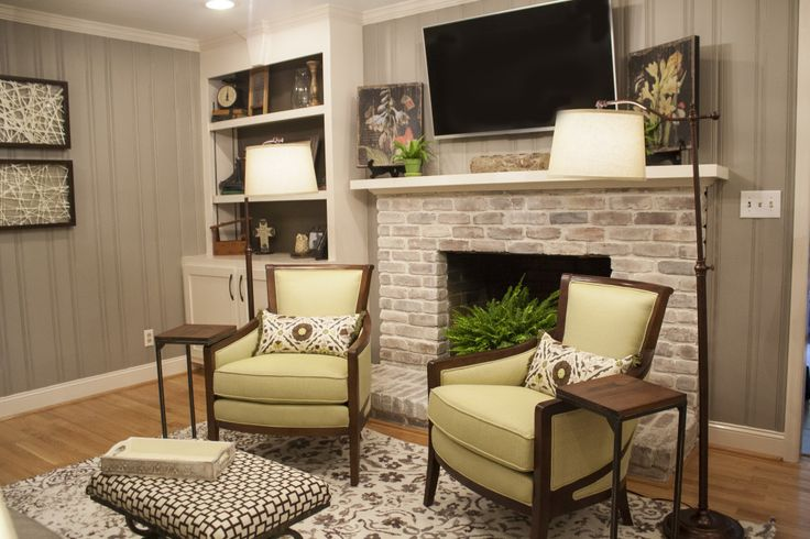 Painted paneling and white washed fireplace