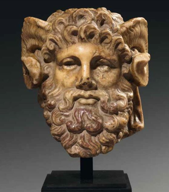 Herm pillar depicting the head of  Zeus Amon, with ram horns.  Giallo Antico.  Roman,  1st. century B.C-1st century A.D.