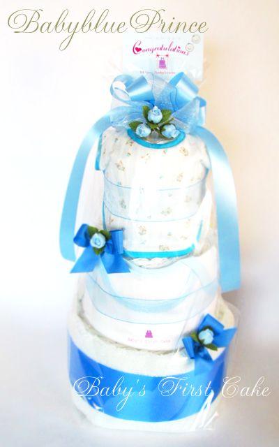 ベイビーブループリンス☆new☆とにかく可愛い3段おむつケーキ・BABYグッズも3アイテム [ 大きさ (約)W26xD26xH45cm ] [ 内容 : 紙オムツ(Sサイズ・Mサイズ):32~35個、肌着ロンパス80サイズ1枚、スタイ1枚、 フェイスタオル1枚、アートフラワー、リボン、カード]
