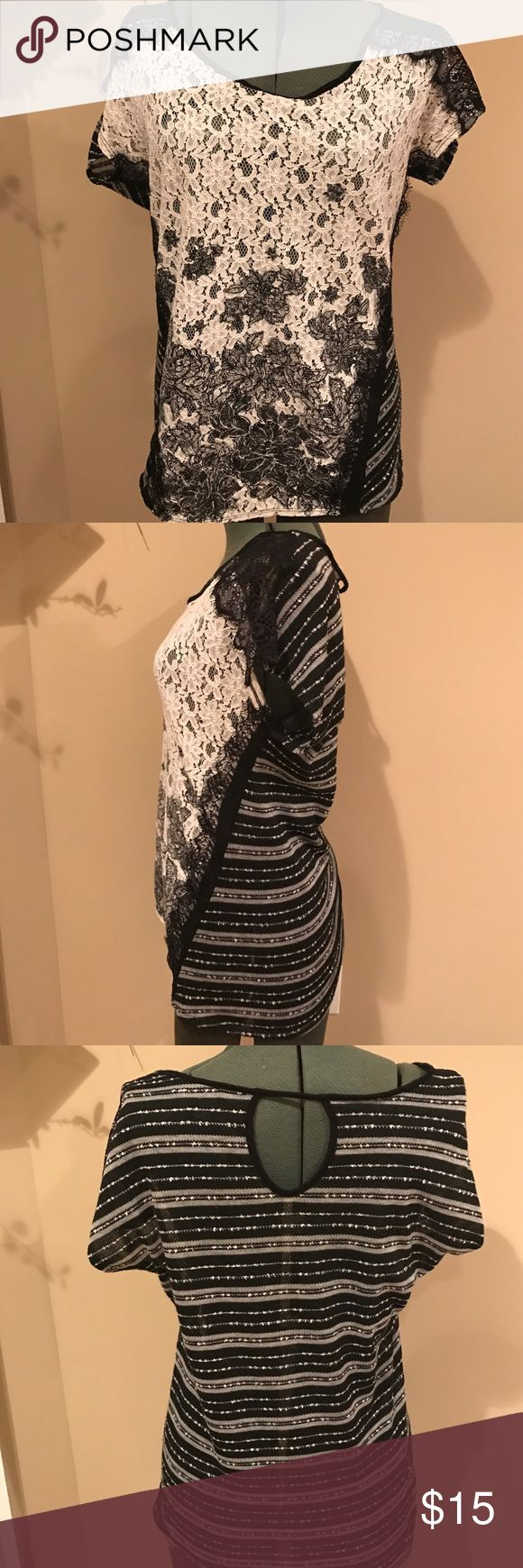 Daytrip Black and White short sleeve shirt sz s Excellent condition Daytrip black and white lace top. It was purchased at Buckle and is in excellent condition. Comes from a smoke free and pet free home. Bundle and save on shipping. Daytrip Tops Tees - Short Sleeve