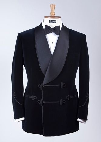 A bespoke midnight blue silk velvet Smoking Jacket Made by Henry Poole Co. - the best of its type you'll ever find. Note the cinched Savile Row sculpted waist.