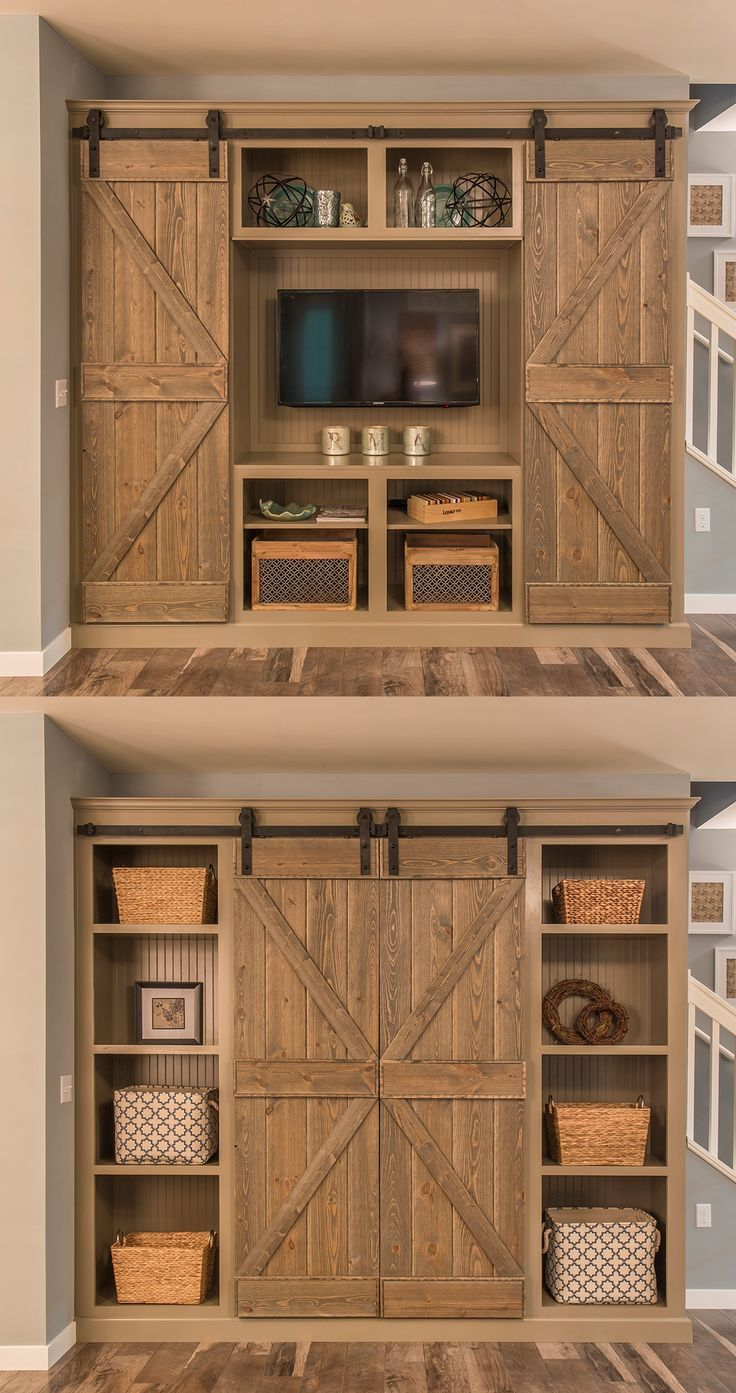 Open the barn doors for a murphy bed in the offuce, and close them for a book shelf - genius! #cottage #rustic