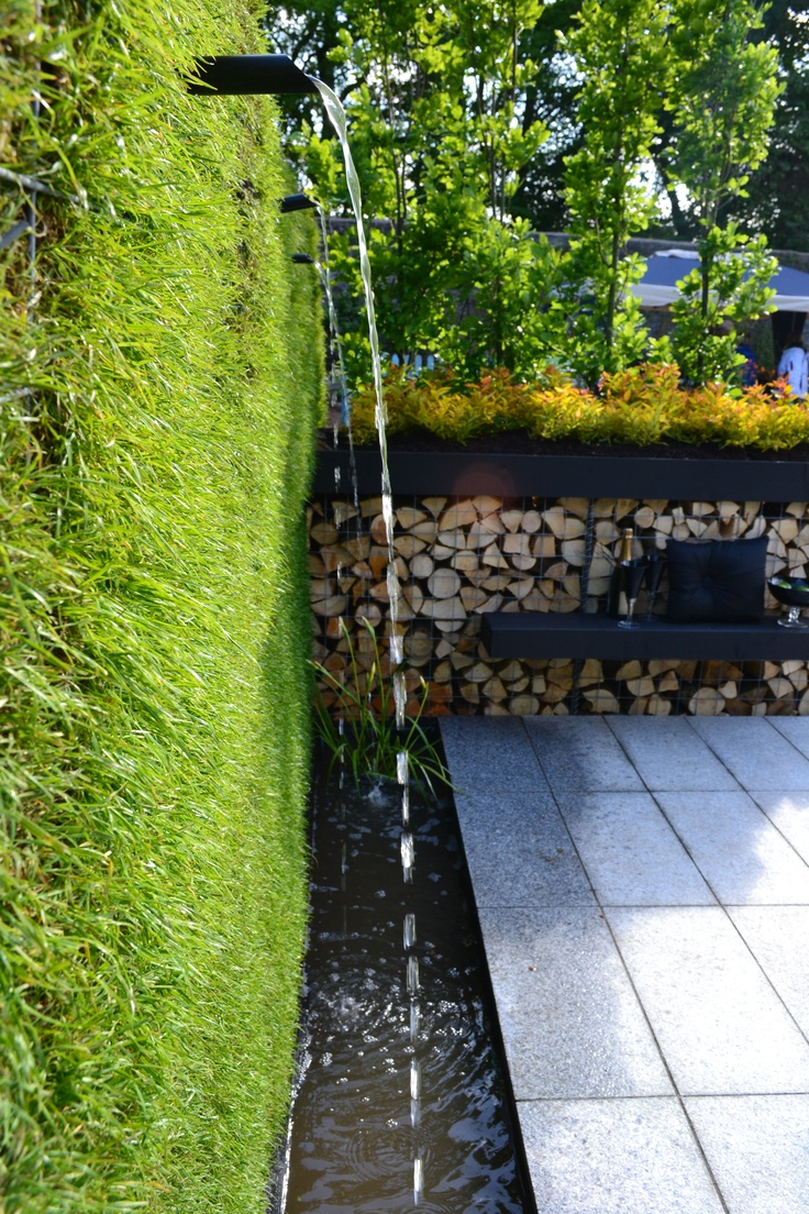 Water feature flowing from the Gabion grass wall in a rill