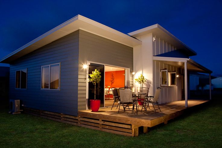 Beautifully lit deck at night. House clad in HardieFlex™ Sheets by James Hardie