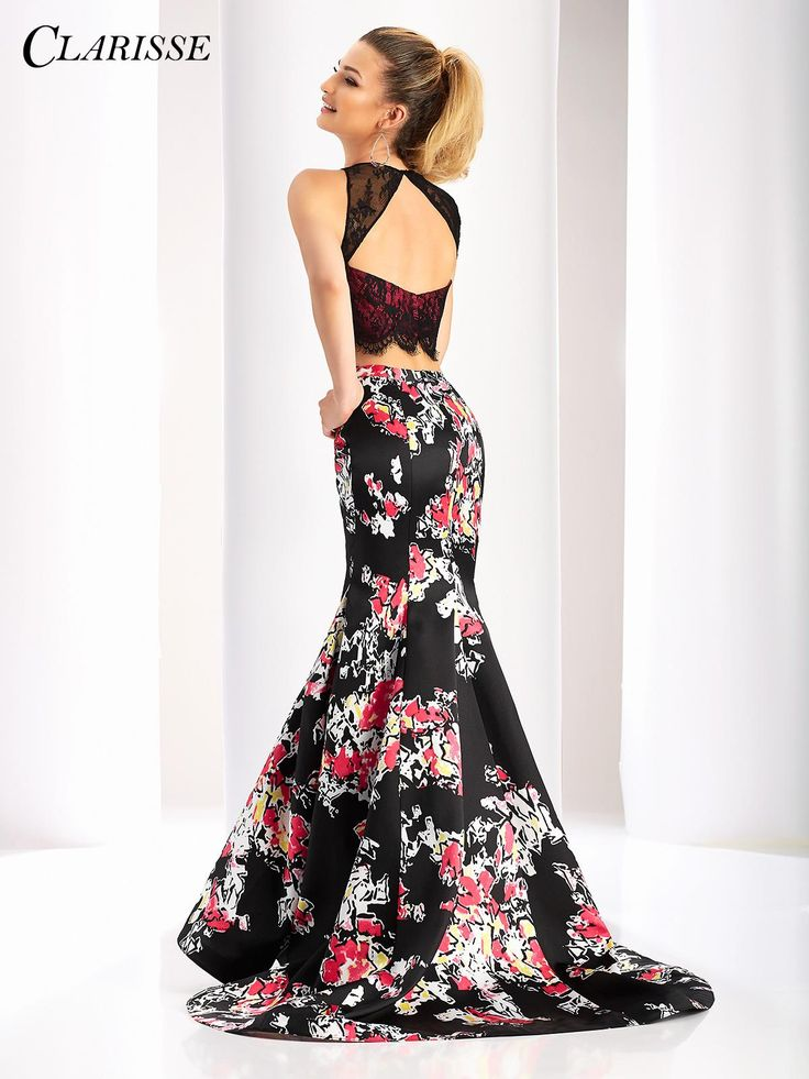 Clarisse Two Piece Printed Mermaid Dress 3209. Stand out and have all eyes on you in this gorgeous two piece mermaid gown with an abstract print and two tone lace top featuring a keyhole open back. Find yours today by clicking the image above! COLOR: Black/Print SIZE: 00-20