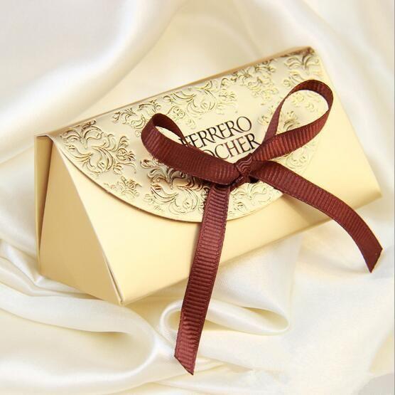 Ucuz 2016 50 adet Yaratıcı Hediye kutusu Ferrero Rocher Kurdele Ile Düğün ve Parti Dekorasyon Favor Kutusu Şeker kutusu kağıt kutular, Satın Kalite etkinlik ve parti malzemeleri doğrudan Çin Tedarikçilerden: 100pcs/lot Ribbons Are Included Wedding Favor Candy Boxes Pink and Purple Colours Wedding Party Gift BoxUSD 20.50/lotHot