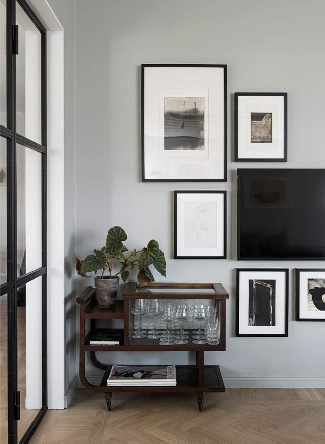 I Love The Placement Of Art Around The TV And The Beautiful Side Unit For  Glassware