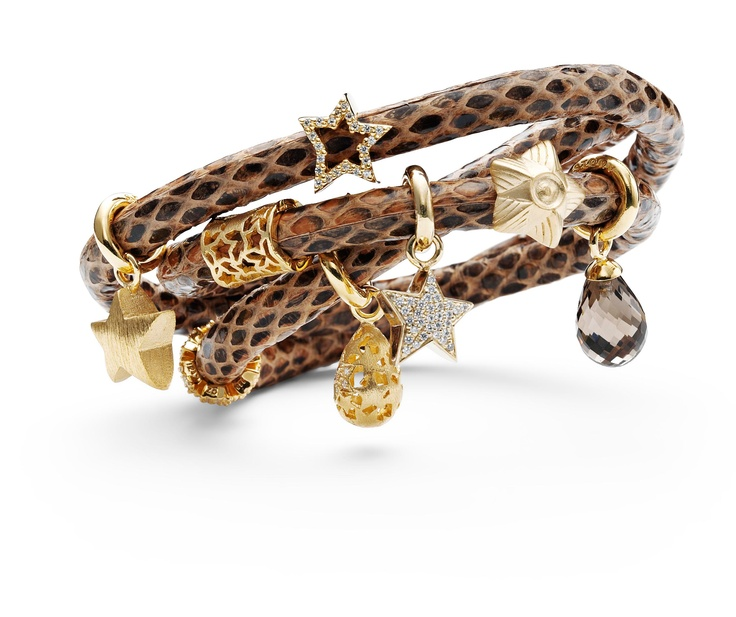Snakeskin bracelet with gold charms by Story.