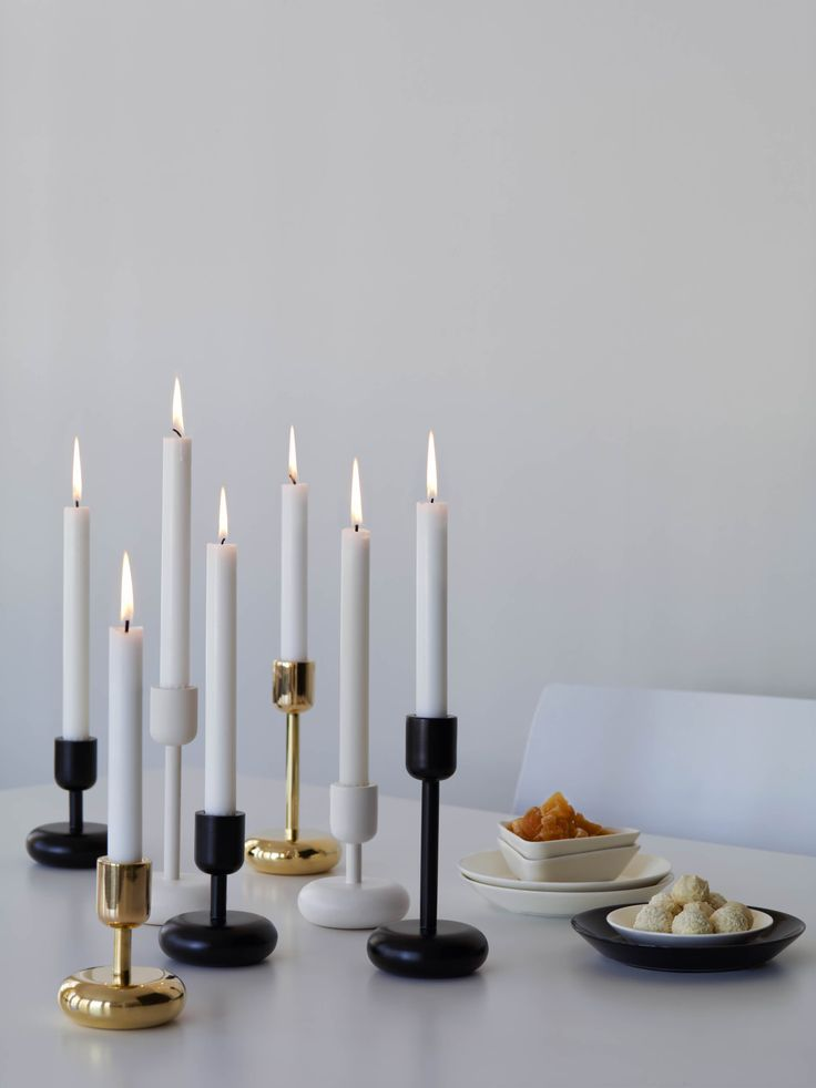 Be inspired by the unusual shape of the Nappula candle holder and the distinct Teema triangles and squares. The different shapes and sizes give you the freedom to be graphical. Dare to break the tradition and start shaping it up with black and white.    www.iittala.com