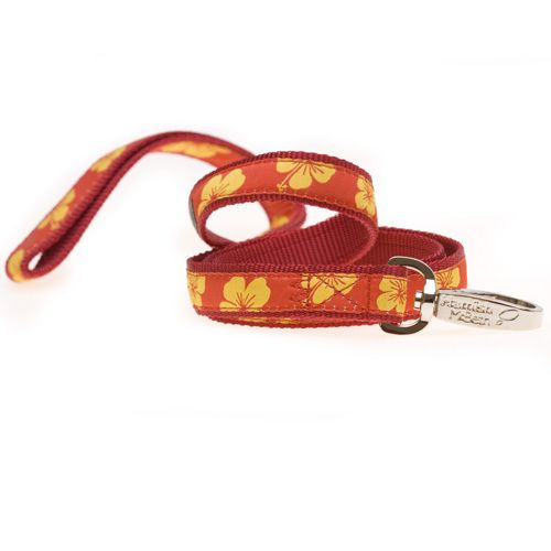 The Hamish McBeth swimmables leashes are ideal for walks on the beach, or on rainy days. These leashes are sturdy and made to last, because only good quality materials won't fray or break at the first sign of tension. The clip and spring are both rustproof, and the bold, bright design matches the same collar in the swimmables range. Yellow hibiscus on red background. #dogleash #doglead #leash #lead
