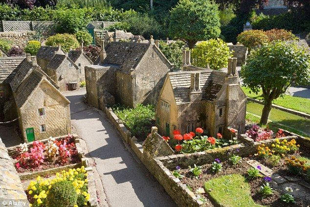 To scale: The actual village has a  117 buildings with Grade II listed status - and now the model version has qualified too thanks to its authentic portrayal of Cotswold style and environment