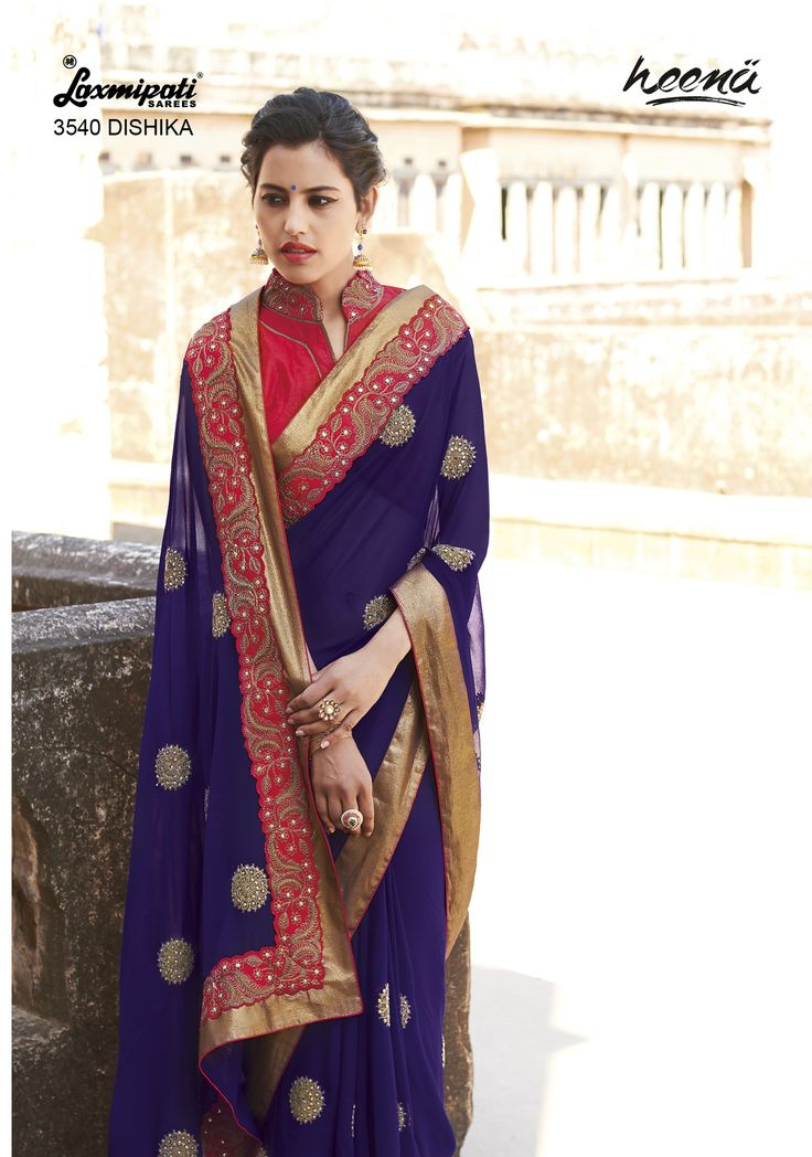 Elegant Violet georgette saree with jari patch one edged lace carrying brocade red blouse.