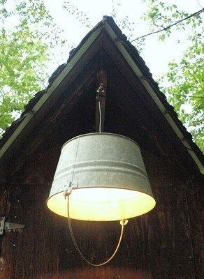 Neat idea for an outside porch lite. Guess most any size bucket would do. i think the more 'beat-up' the better!