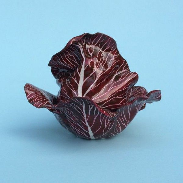 Porcelain Red Cabbage Renowned contemporary French porcelain master has revived the antique craft of making flowers and vegetables that first appeared as art in the 1740's by Vincennes, which were later copied by British porcelain factories such as Chelsea & Longton Hall in the 1750's. Didier worked under the tutelage of world renown French sculptor Jean-Jacques Prolongeau for nineteen years