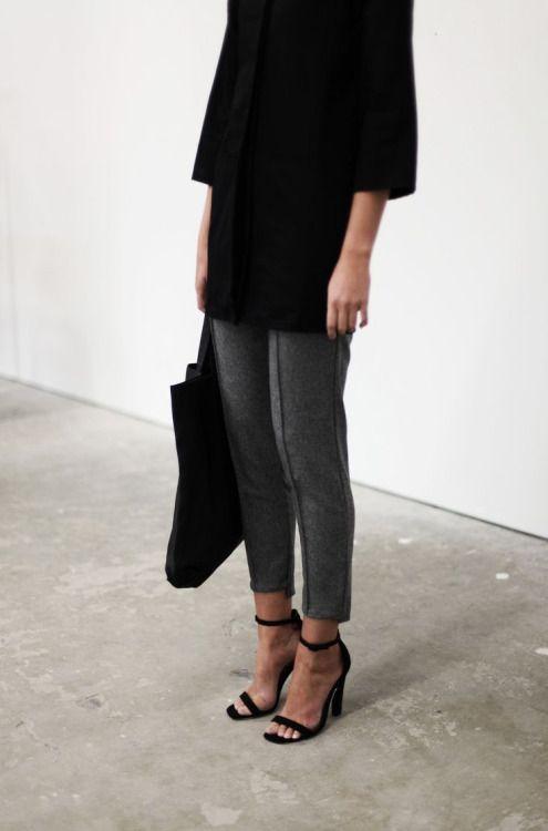 Grey trousers, black top