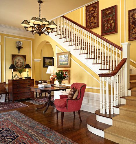 This jaw-dropping staircase in the front entry is just one stunning example of classic architecture in this CA home - Traditional Home® / Photo: Werner Straube / Design: Anna & Alan Clark