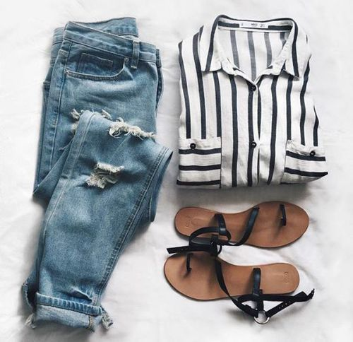 oversized stripe button down with blue ripped jeans and black sandals