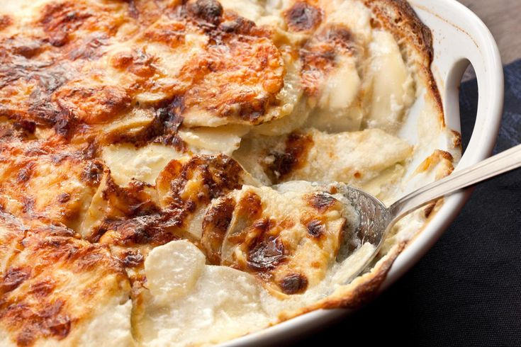 This scalloped potato recipe, also known as potatoes au gratin, layers russet potatoes, half-and-half, and Gruyère cheese and is baked until browned and bubbly.