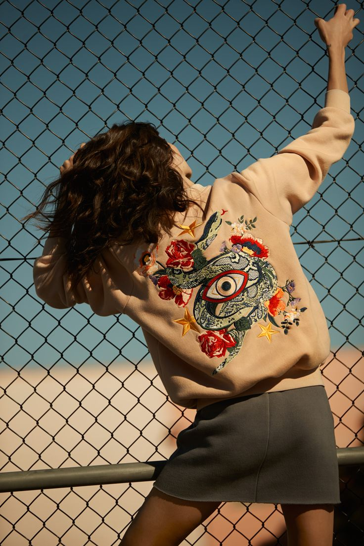Turn heads in statement style with the New Guard Tempted by Fate Embroidered Bomber Jacket in Blush - Shot by Georges Antoni