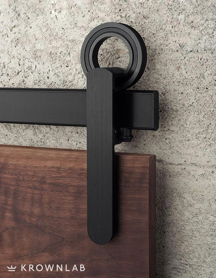 Baldur Sliding Door Hardware Makes A Statement With A Unique Hubless Design Etched Black Sta Wood Doors Interior Sliding Barn Door Hardware Barn Door Hardware