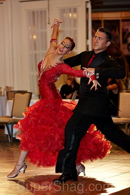 Vivid red ballroom gown with ruffles galore from hip to heels, captured at the Caribbean Classic 2012!