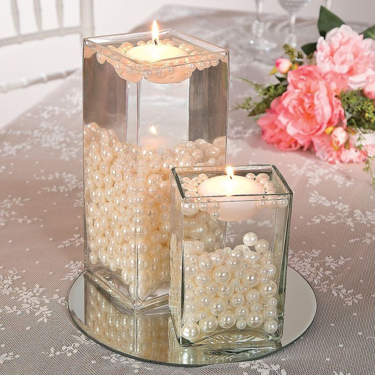 Easy Pearl Bead Centerpiece Idea | Simple, elegant and stunning! This DIY centerpiece adda a rich, opulent look to your wedding and couldn't be any easier to make. Click on the image to learn how!