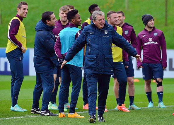 England manager Roy Hodgson (Foreground) takes part in a squad training session at St George's Park near Burton-on-Trent, central England, on November 14, 2014, on the eve of their Euro 2016 qualifying match against Slovenia at Wembley Stadium on November 15, 2014.