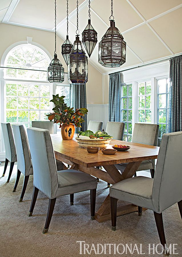 hung at staggered heights luminous lanterns for light from morocco cast a dazzling glow on a rustic wooden table photo john bessler design young huh - Dining Room Hanging Light Fixtures