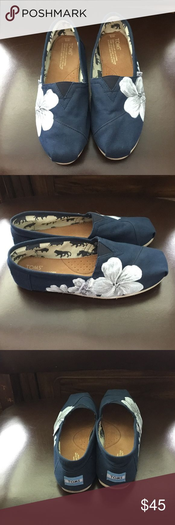 Navy TOM'S with hand painted white flower design Gently used Tom's. Beautiful hand painted flower detail on sides. Super cute for summer! TOMS Shoes Flats & Loafers