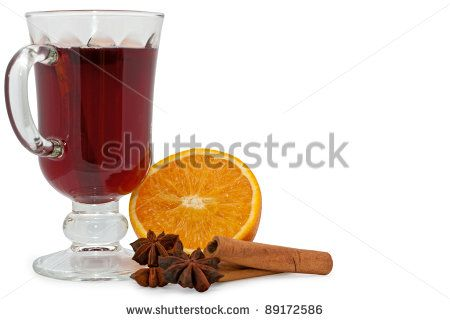 Christmas hot wine with orange, star anise and cinnamon over white background - stock photo