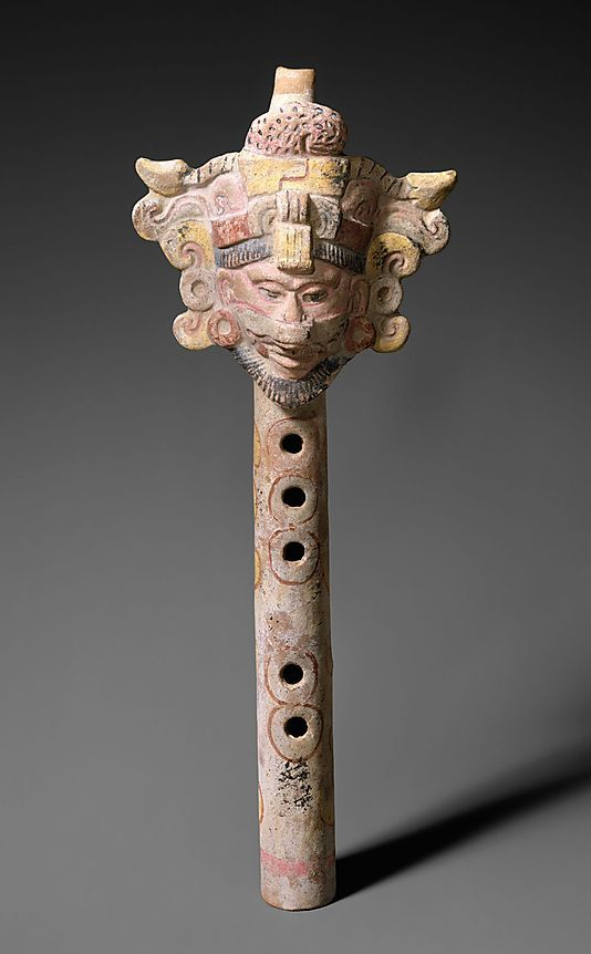 Fipple Flute    Period:      Pre-Columbian  Date:      ca. 600–900  Geography:      Mexico  Medium:      Pottery, polychrome  Dimensions:      12.1 x 2.7 x 28.9 cm (W. applied figure 4-3/4 x Tube Diam. 1-1/16 x L. 11-3/8 in.)  Classification:      Aerophone-Whistle Flute
